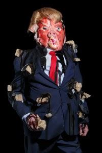 Trump sculpture with pig's snout and sheep eyes featured